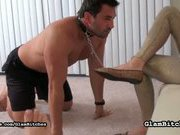 Brunette mistress with her foot slave
