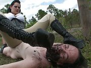Hot mistress in boots tramples slave