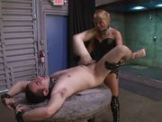 Hot babe with strapon fucks slave