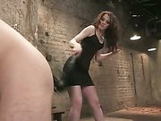 Beautiful Red Head Dominatrix spanks slave
