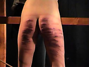 Whipping and caning in the dark room