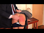 Embarrassed blond schoolgirl was spanked by teacher