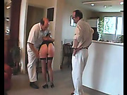 Two guys spanked one slutty woman