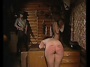 Perverted doctor is caning a girl