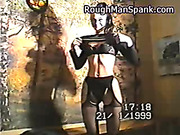 Cuffed and tied to bench brunette wants spanking
