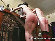 Two sluts were caned by the fireplace