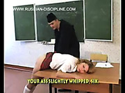 Young schoolgirl was spanked with wooden paddle