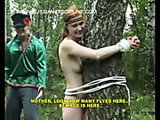 Bound Russian babe spanked in the forest