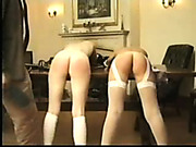 Bare bottoms spanked in the field