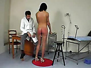 Pantyhose brunette spanked in the medical room