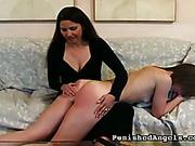 Brunette spanked by Mom