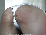 Rosie Munroe waits for 12 strokes of the cane