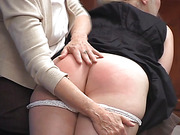 Spanked, blushing seat of a naughty, punished lady