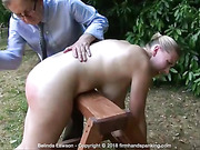 Belinda Lawson spanked and slippered topless over a
