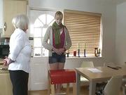 Grandma spanked on the kitchen