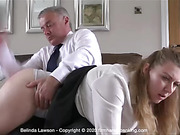 Belinda Lawson accepts a bare spanking over her boss' knee