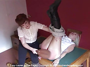 Lucy Lauren's bare buttocks spanked long and hard with a