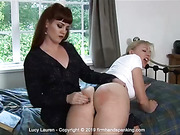 Spanked long and hard, bottom bare: Lucy Lauren pays the