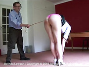 Touching her toes, bottom bare, Belinda Lawson feels the