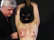 Masked slut whipped