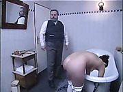 Fat dude caned young girl in the bathroom