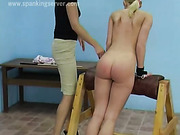 Two sexy blondes practice caning action