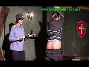 Tied prostitute whipped by female police officers