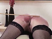 Sexy MILF in nylons was caned on the sofa