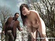 Fuckable brunet babe got OTK spanking outdoors