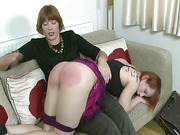 Teen ass spanked by lesbo mature bitch