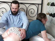 Bearded dude OTK spanked and strapped two babes
