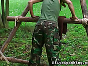 Hard caning punishment in military style
