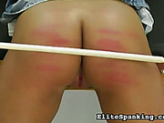 Merciless mistress  gave hard caning  to tied brunette