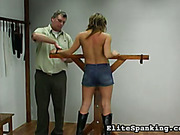 Tied and body bullwhipped topless young blonde