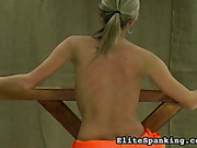 Poor prisoned blonde suffered from back whipping