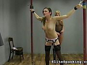 Young tied bitch was severely whipped by blonde