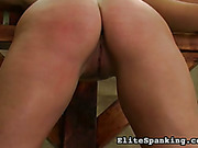 Tied babe got ass paddled by two punishers