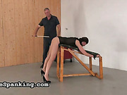 Weird and painful spanking experiment with cute brunette