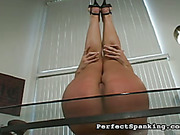 Experienced lesbian spanker paddled and strapped brunet