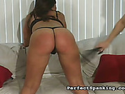 Hard strapping and spanking for young bubble butt