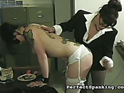Tattooed female secretary spanked by lady boss