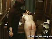 Cruel mistress spanked bare asses of schoolgirls