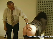 Big ass of brunet secretary suffered from paddling