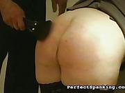 Big ass of brunet secretary suffered from paddling