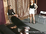 Redhead mistress paddled and caned spread legged slut