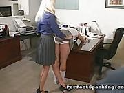Harsh OTK spanking for brunette in the office