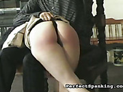 Young wife OTK spanked and paddled by hubby