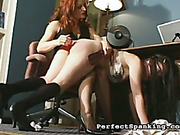 Brunette OTK spanked and abused by redhead mistress