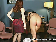 Two schoolgirls strapped in the headmistress' office