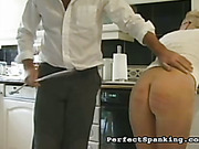 Nude ass suffering from kitchen OTK spanking